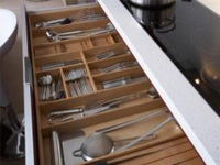 a custom designed silverware and utility drawer system in a Hayward home