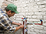 a Hayward handyman patches a damaged pipe