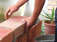 a brick wall being constructed on a patio